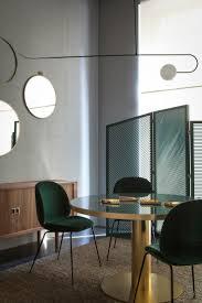 dark green chairs spotti showroom milan italy the cool