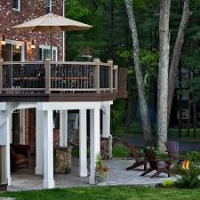 Composite Patio Pavers by Screened Porch With Under Decking System And Paver Patio