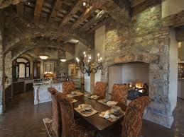 exposed wood beams and rough grained stone work capture the charm