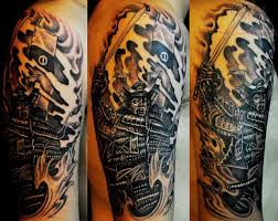 japanese mask and snake tattoos on lower arm photos pictures