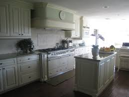 raised kitchen cabinets white kitchen cabinetry with fluting and raised panel doors