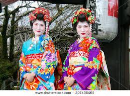 KYOTO  JAPAN   CIRCA APRIL       Japanese women  female beauty  geishas  posing Inside Japan Tours