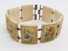 battle saints bracelets catholic co 20 wood saints fancy bracelet sepia images