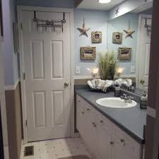 bahtroom big vanity under twin mirror beside wall lamp and crab soothing nautical bathroom decor ideas making absolute coziness in tiny space usual door model installed