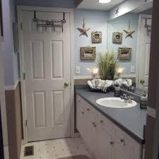 bahtroom usual door model installed iron hook beside wall art