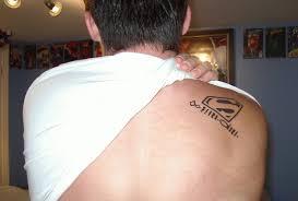 superman logo tattoo design on shoulder tattoomagz