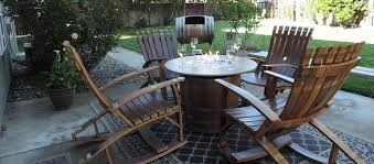 wine barrel fire table barrel tables for the patio american gardener