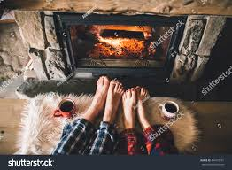 royalty free bare couple feet by the cozy fireplace u2026 442475791
