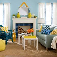 soft blue wall color with beige sisal rug and white fireplace for