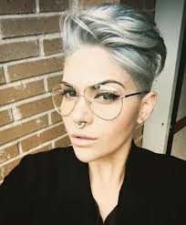 very short pixie hairstyle with saved sides pixie cut short sides long top