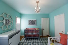 bedroom baby room with tiffany blue paint and modern chandelier