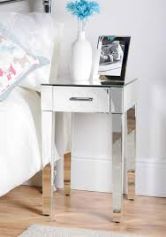bedroom full designed mirrored bedside table with blue flower in