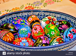 painted wooden easter eggs colorful painted wooden easter eggs in a ceramic bowl stock