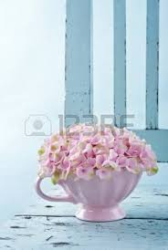 bouquet of white lilac spring flowers in a wooden blue vase on