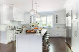 white kitchen cabinets with oak floors oak floors transitional kitchen kathy tracey design