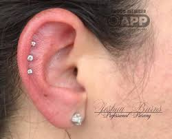 earring that connects to cartilage 50 cartilage piercings for an edgy look