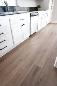 white kitchen cabinets with vinyl plank flooring luxury vinyl plank faq cutesy crafts
