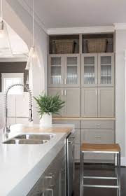 160 best paint colors for kitchens images on pinterest kitchen pavestone sw 7642 on the cabinets adds dimension to a chic understated kitchen color scheme