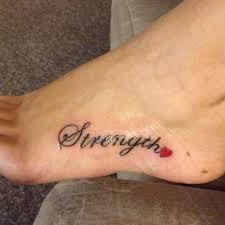 nice strength heart tattoo on foot