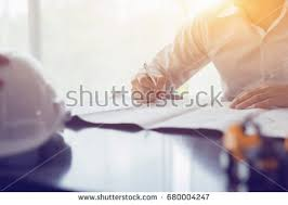 Architecturals Architect Working On Blueprint Architects Workplace Stock Photo