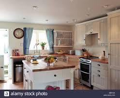 kitchen central island shaker style kitchen with white panel cupboards and central island