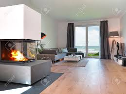 Livingroom Fireplace by Modern Living Room With Fireplace And A View To The Sea Stock