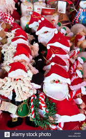 of jolly crafted santa claus tree ornaments displayed
