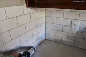How To Install A Tile Backsplash In Kitchen by Duo Ventures Kitchen Update Grouting U0026 Caulking Subway Tile