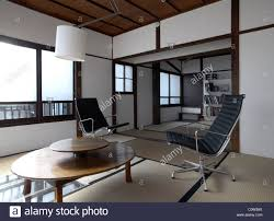 contemporary tatami room with charles eames office chairs in a
