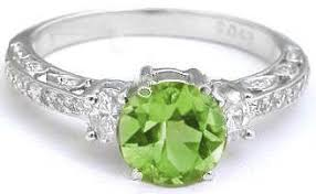 peridot engagement ring vintage inspired peridot and oval engagement ring and