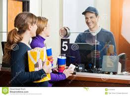 women buying movie tickets from seller at box stock image image