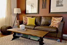 painted black and stained trestle style coffee table with brown