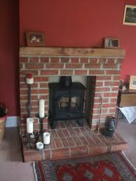 ferring couple thrilled with new fireplace and woodburner
