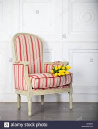 classic armchair one classic armchair against a white wall and floor copy space