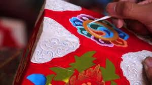 nepali craftsman drawing hindu style ornaments on the casket stock
