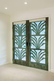 beige green tropical entrance hawaii white walls double door green door beige