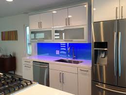 kitchen backsplash panels kitchen rear wall has a backlit glass niche with integrated socket