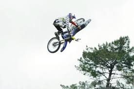 first motocross bike motocross rider thomas pages flips bike in mid air