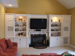 built in entertainment center with electric fireplace interior large white wooden cabinet with television on