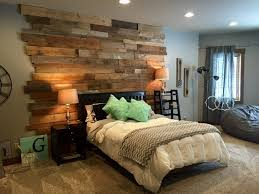staggered barnwood wall rustic bedroom st louis by reclaim