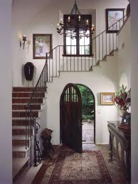 Spanish Style Home Decorating Ideas by Living Room Neautral Spanish Design On Entrance And Stairs With
