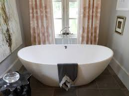 tub and shower combos pictures ideas tips from hgtv rustic neutral bathroom with exposed beams and stone mosaic floor