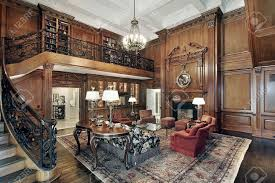 living room in mansion with second story balcony stock photo