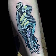 little fantasy style colored forearm tattoo of hand with knife