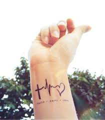 heartbeat stop tattoo 27 awesome cross ekg heart faith hope love heartbeat tattoos on