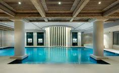 Indoor Pool Design Luxurious Indoor Pool With An Attached Sauna And Shower Area