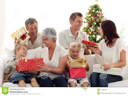 happy family opening presents on stock image