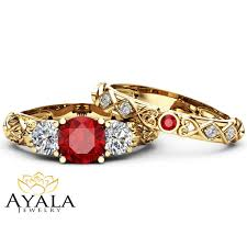 rings art images Unique ruby and moissanite three stone bridal set 14k yellow gold jpg