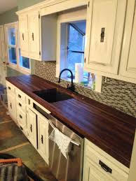 decor walnut butcher block with stove and white wall for kitchen