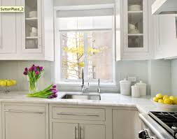 light grey kitchen cabinets gray cabinets and white appliances